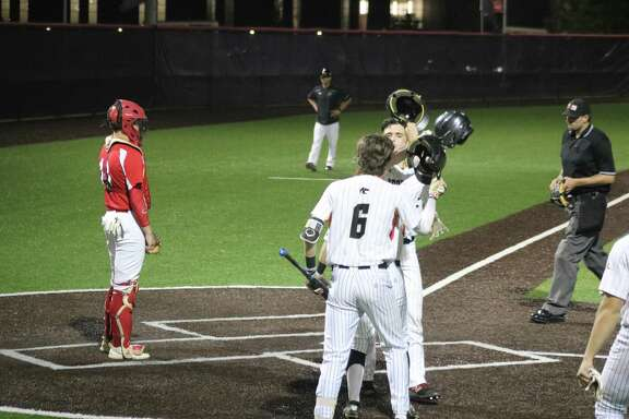 Northland Christian's Landon Murray (6) and Brady Kraner greet Marshall Ingram at home plate after Ingram belted a game-tying two-run homer in the Division 3 state semifinal game. Murray was moments away from also going deep. Northland Christian went on to win the state title the next day.