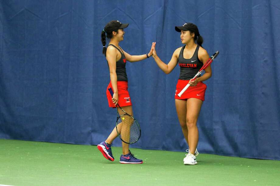 Wesleyan tennis players Victoria Yu, left, and her sister Kristina Yu will be competing in the NCAA Division III tournament this week. Photo: Ryan Nye / Wesleyan University Athletics