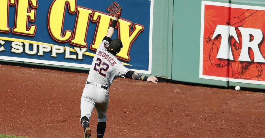 Houston Astros right fielder Josh Reddick leaps but can't get to a double by Boston Red Sox's Mookie Betts during the fifth inning of a baseball game Sunday, May 19, 2019, at Fenway Park in Boston. (AP Photo/Winslow Townson) Photo: Winslow Townson/Associated Press