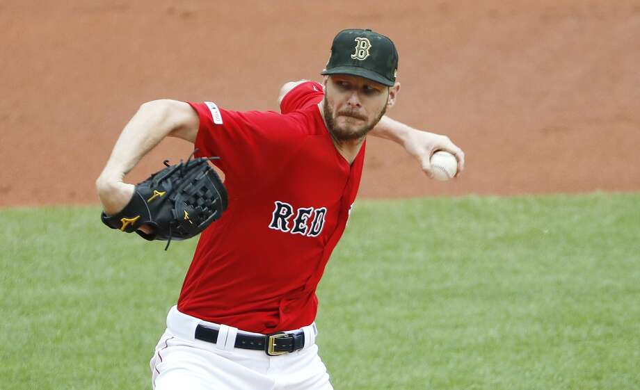 PHOTOS: 2019 Astros game-by-game  Boston Red Sox starting pitcher Chris Sale delivers against the Houston Astros during the first inning of a baseball game Sunday, May 19, 2019, at Fenway Park in Boston. (AP Photo/Winslow Townson) >>>See how the Astros have fared so far this season ...  Photo: Winslow Townson/Associated Press
