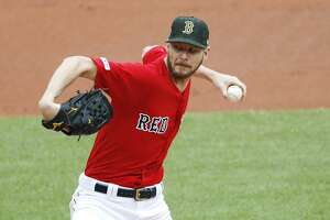 Boston Red Sox starting pitcher Chris Sale delivers against the Houston Astros during the first inning of a baseball game Sunday, May 19, 2019, at Fenway Park in Boston. (AP Photo/Winslow Townson)