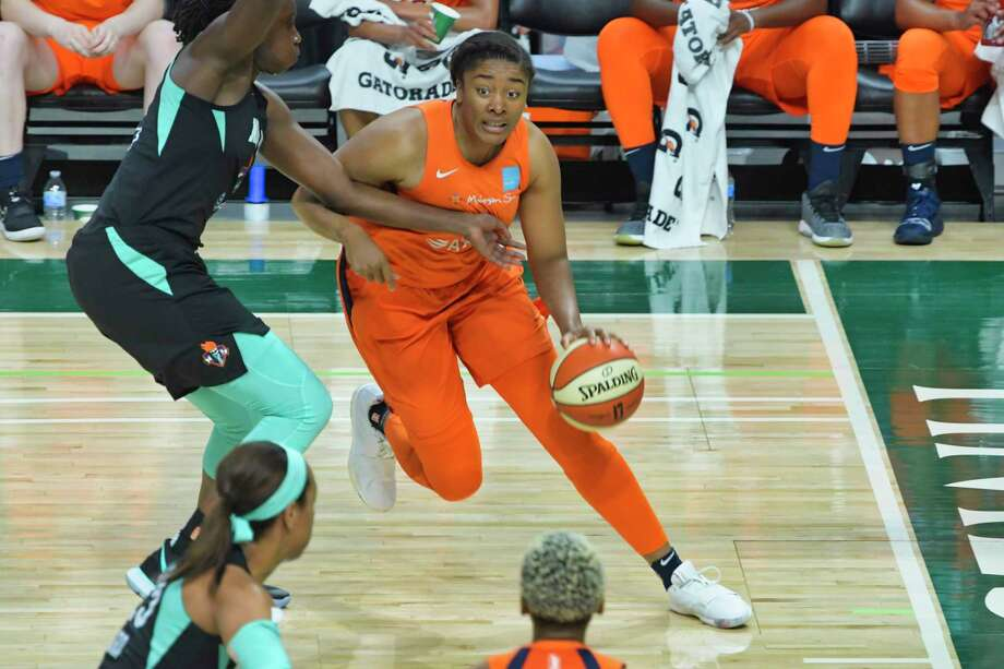 Morgan Tuck of the Connecticut Sun drives around a New York Liberty player during their preseason game at the Times Union Center on Sunday, May 19, 2019, in Albany, N.Y.   (Paul Buckowski/Times Union) Photo: Paul Buckowski, Albany Times Union / (Paul Buckowski/Times Union)