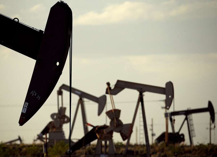 FILE - In this April 24, 2015, file photo, pumpjacks work in a field near Lovington, N.M.  Photo: Charlie Riedel, Associated Press