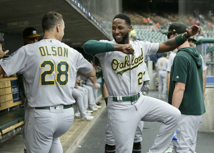 DETROIT, MI - MAY 19:  Matt Olson #28 of the Oakland Athletics dances with Jurickson Profar #23 before a game against the Detroit Tigers at Comerica Park on May 19, 2019 in Detroit, Michigan. Play was suspended in the seventh inning due to rain with Oakland leading 5-3. The game will resume Sept. 6 at Oakland.(Photo by Duane Burleson/Getty Images)