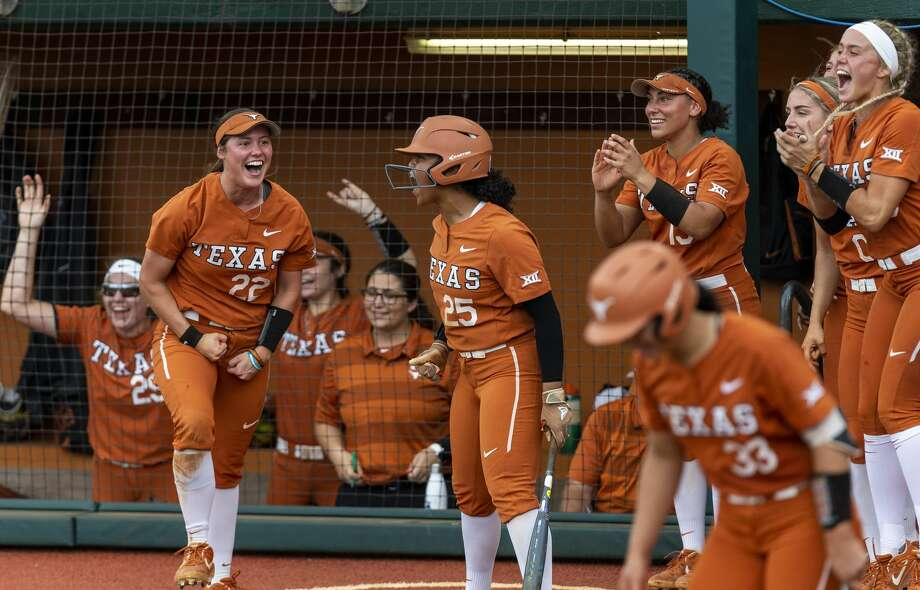 Texas dugout celebrates a double against Texas A&M during an NCAA college softball tournament Austin Regional game, Saturday, May 18, 2019.(Stephen Spillman / for Express-News) Photo: Stephen Spillman / For Express-N
