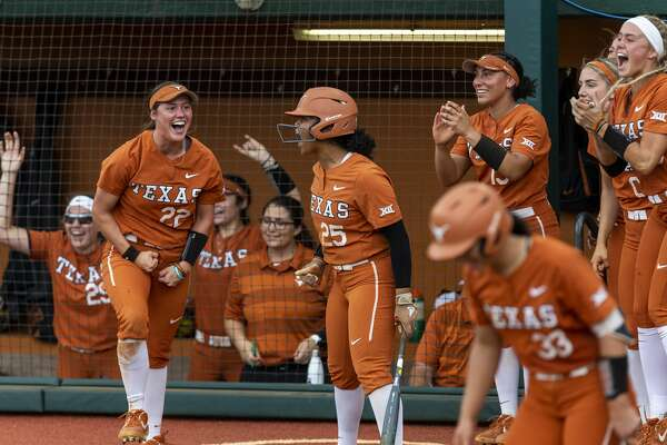 Texas dugout celebrates a double against Texas A&M during an NCAA college softball tournament Austin Regional game, Saturday, May 18, 2019.(Stephen Spillman / for Express-News)