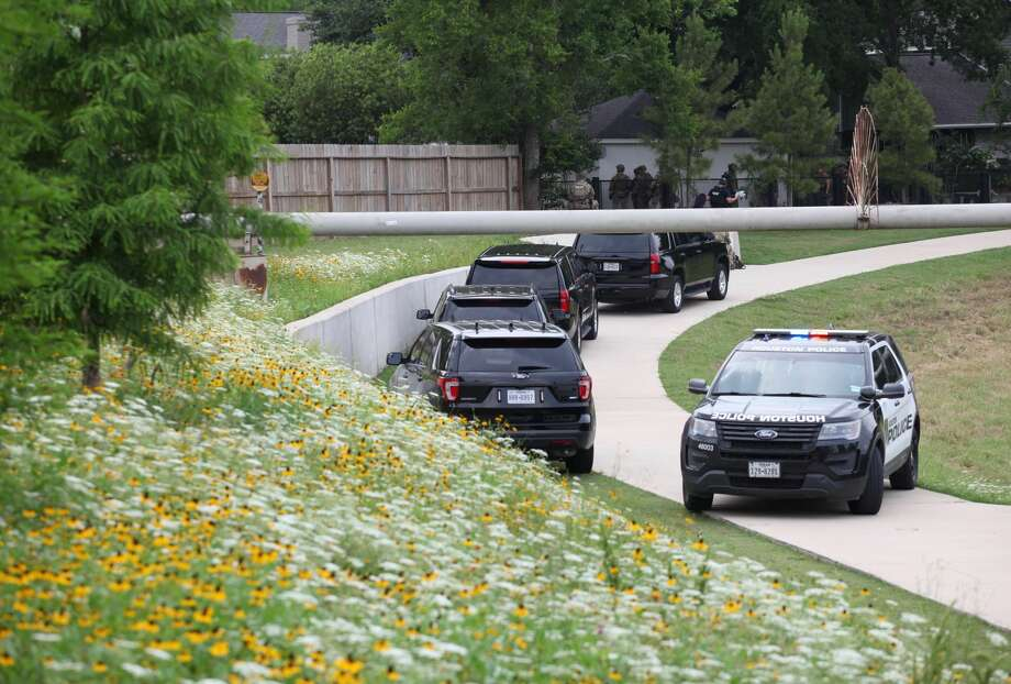 Police stand outside a home in the 7000 block of Bent Branch Road on May 19, 2019, after a receiving a report of suspected burglar inside. Photo: Nicole Hensley/Houston Chronicle