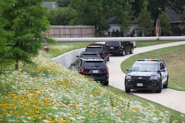 Police stand outside a home in the 7000 block of Bent Branch Road on May 19, 2019, after a receiving a report of suspected burglar inside.