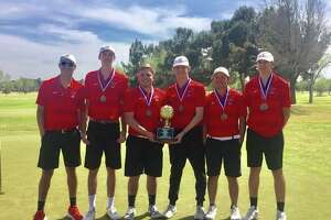 The Garden City boys golf team poses with the District 8-1A championship trophy, April 2 at Ranchland Hills Golf Club.