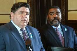 With Acting Director Marc Smith looking on, Gov. J.B. Pritzker talks about addressing the recommendations in a study for reforming the state's Department of Children and Family Services. During a news conference Wednesday, May 15, at the Capitol in Springfield, Pritzker said he will carry out all recommendations, which include working with courts and prosecutors to refine the criteria used for removing children from their homes, refining protocols for closing Intact Family Services cases, and improving the quality of supervision within the agency to provide more clear lines of authority and supervision.