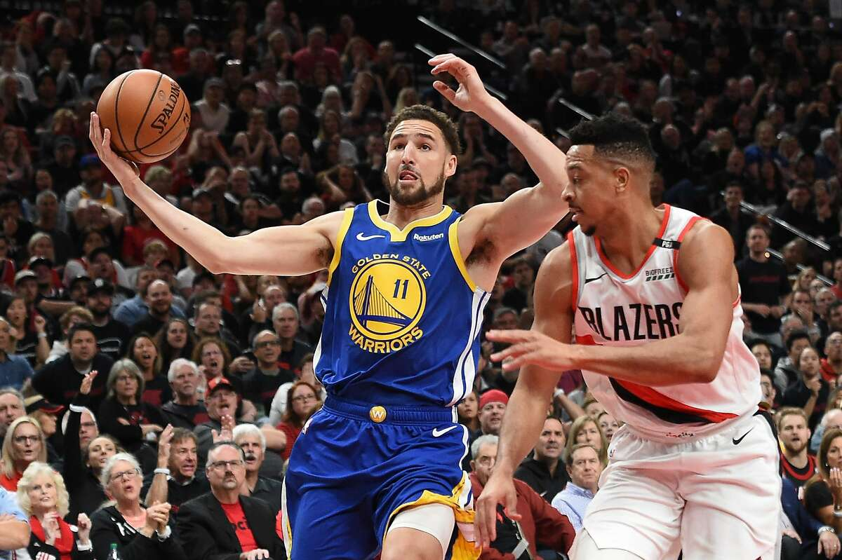 Klay Thompson of the Golden State Warriors drives to the basket against the Portland Trail Blazers in game three of the NBA Western Conference Finals at Moda Center on May 18, 2019 in Portland, Oregon.