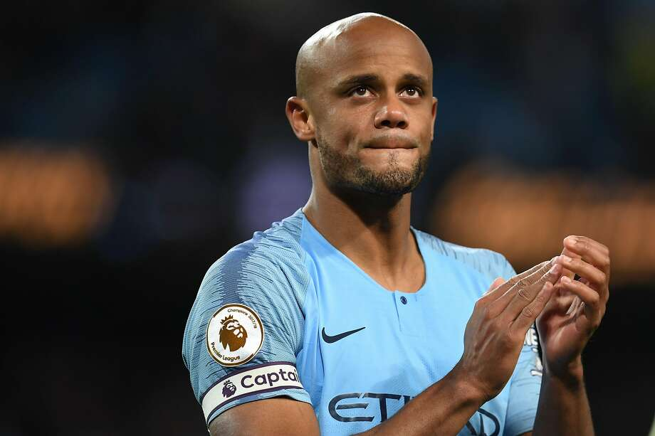 (FILES) In this file photo taken on May 6, 2019 Manchester City's Belgian defender Vincent Kompany takes part in a lap of appreciation after the final whistle of the English Premier League football match between Manchester City and Leicester City at the Etihad Stadium in Manchester, north west England. - Club captain Vincent Kompany announced Sunday, May 19 that he is to leave Manchester City after 11 trophy-laden years. (Photo by Paul ELLIS / AFP) / RESTRICTED TO EDITORIAL USE. No use with unauthorized audio, video, data, fixture lists, club/league logos or 'live' services. Online in-match use limited to 120 images. An additional 40 images may be used in extra time. No video emulation. Social media in-match use limited to 120 images. An additional 40 images may be used in extra time. No use in betting publications, games or single club/league/player publications. / PAUL ELLIS/AFP/Getty Images Photo: PAUL ELLIS;Paul Ellis / AFP / Getty Images