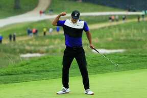 Brooks Koepka reacts after putting on the 18th green during the final round of the 2019 PGA Championship at the Bethpage Black course on May 19, 2019 in Farmingdale, New York.