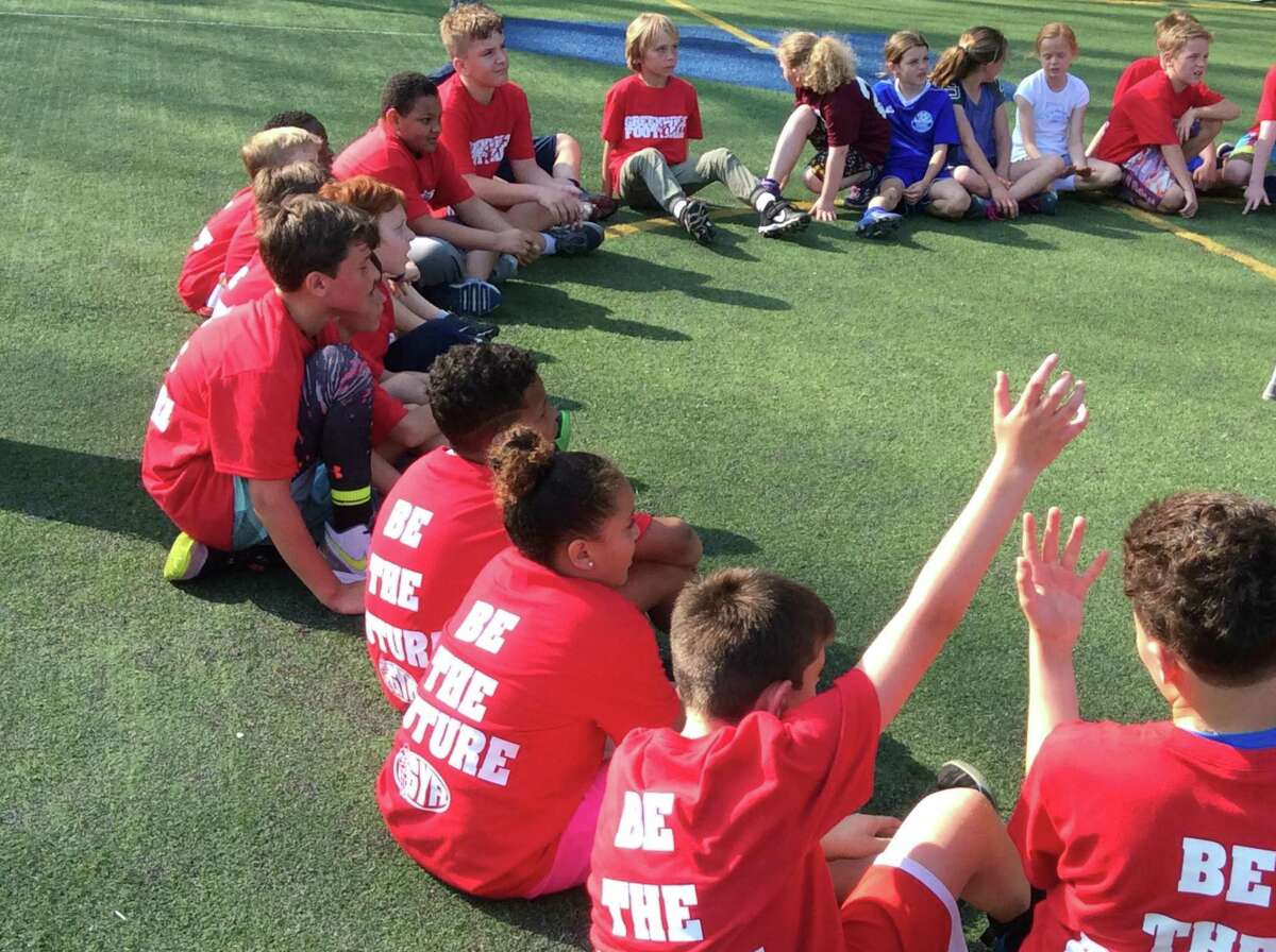 Youngsters gather during a clinic run by the players and coaches of the 2018 Greenwich High School football team on Sunday, May 19, 2019, at the Boys & Girls Club of Greenwich.