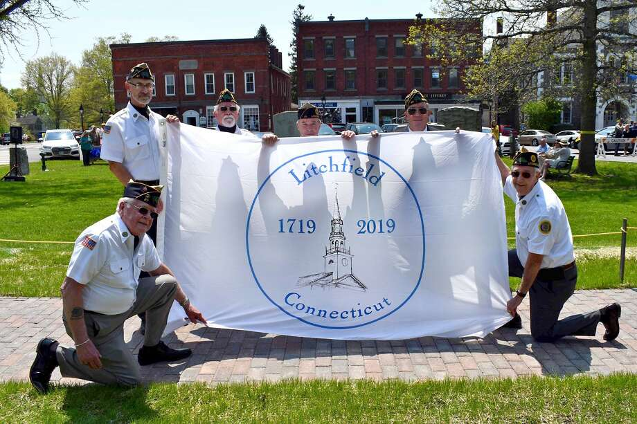 The town of Litchfield kicked off its 300th birthday celebration on May 19 with an ecumenical service and speeches on the Green, as well as a comemmorative flag unveiled by members of Morgan Weir Post 27 American Legion. Many events are planned through the end of the year. Photo: Lara Green-Kazlauskas / For Hearst Connecticut Media /