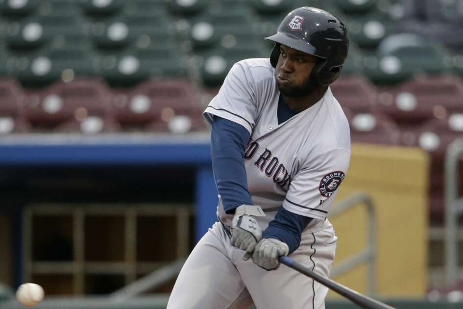 In this May 7, 2019 photo, Round Rock designated hitter Yordan Alvarez, who leads the Triple A league with 13 home runs, swings for the ball. The new official Triple A league baseball is now the same as the big-league ball. It is said to be harder, more tightly wound at its core and with slightly lower seams, all of which make it more aerodynamic than the ball used at the Double A level and lower and previously in Triple A. As of May 8, 2019, home runs in Triple A were up 64 percent over a comparable period in 2018 (1,202 homers vs. 732), according to figures MLB provided to The Associated Press. (AP Photo/Nati Harnik)