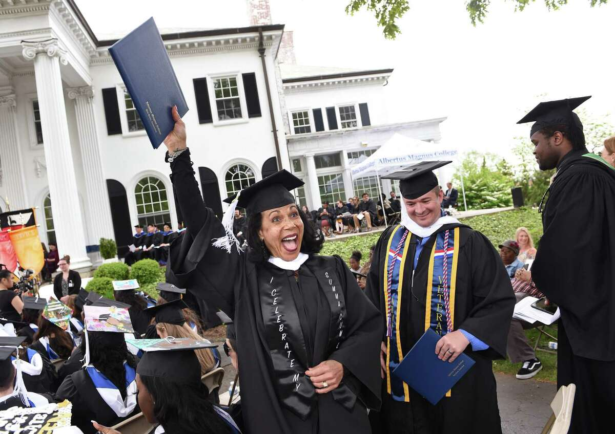 Elizabeth Loring of West Haven waves to family after receiving her degree at the Albertus Magnus College Commencement in New Haven on May 19, 2019.