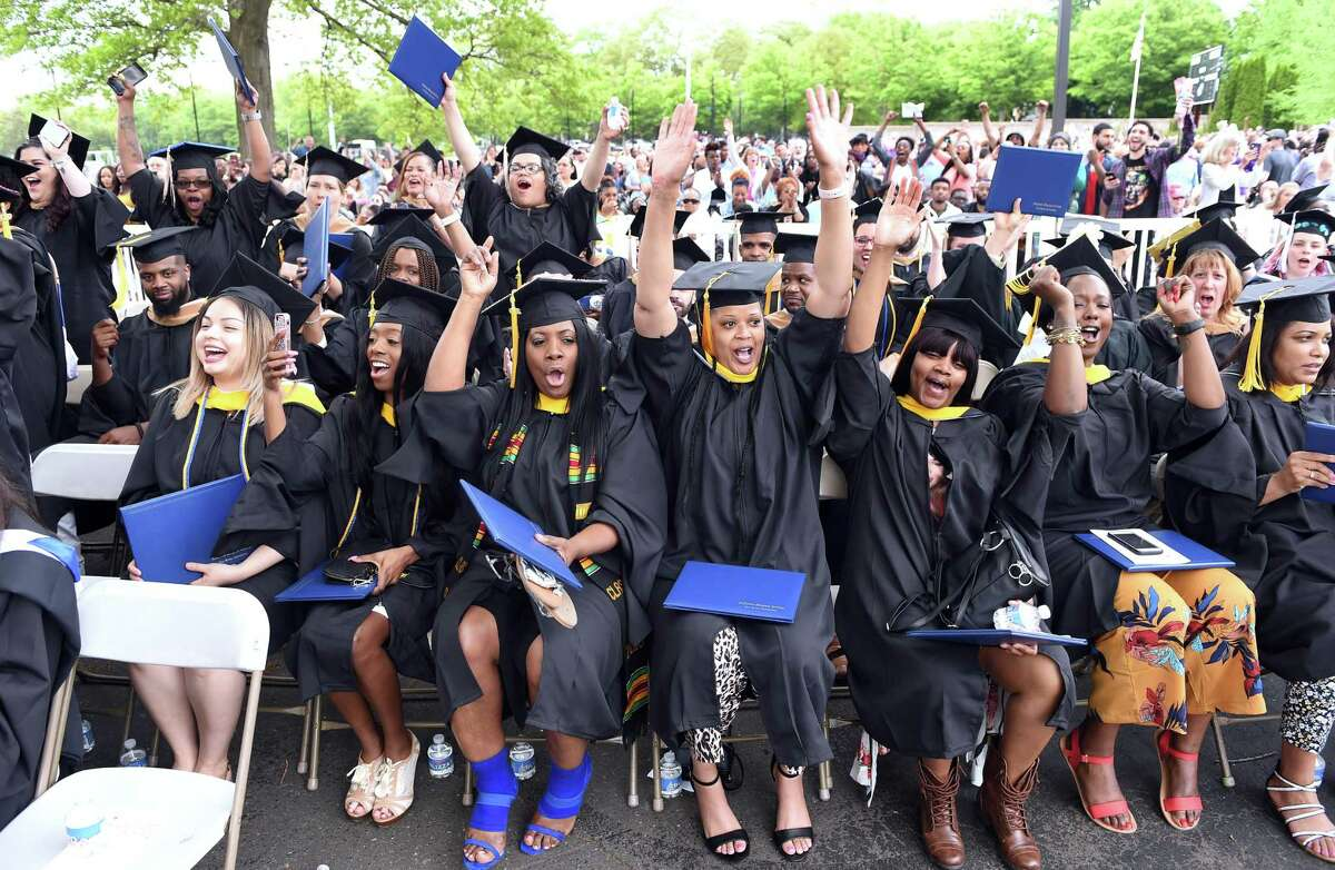 Graduates celebrate near the end of the Albertus Magnus College Commencement in New Haven on May 19, 2019.