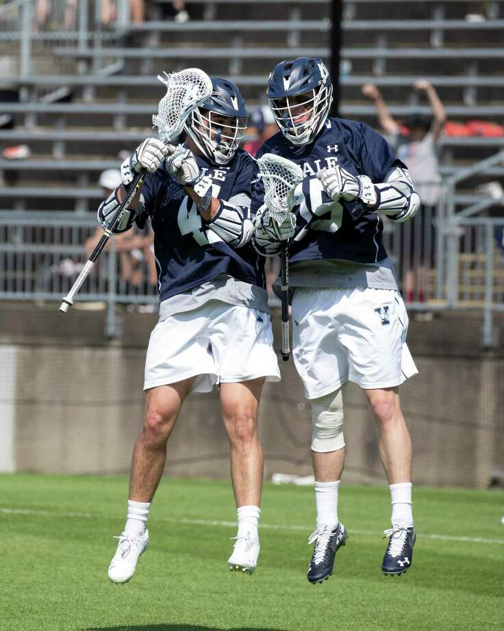 Yale's Jackson Morrill and teammate Matt Brandau celebrate Morrill's first-period goal against Penn on Sunday. Photo: Steve Musco / Yale University Athletics / ©2018 - 2019 Steve Musco , All rights reserved