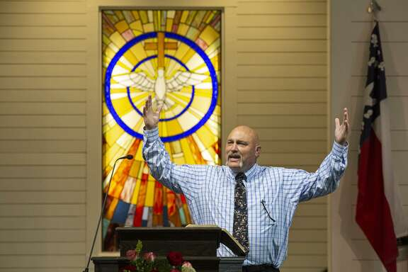 Pastor Frank Pomeroy speaks from the pulpit Sunday during the private service for church members, survivors and victims' families, the first service held in the new building for First Baptist Church of Sutherland Springs.