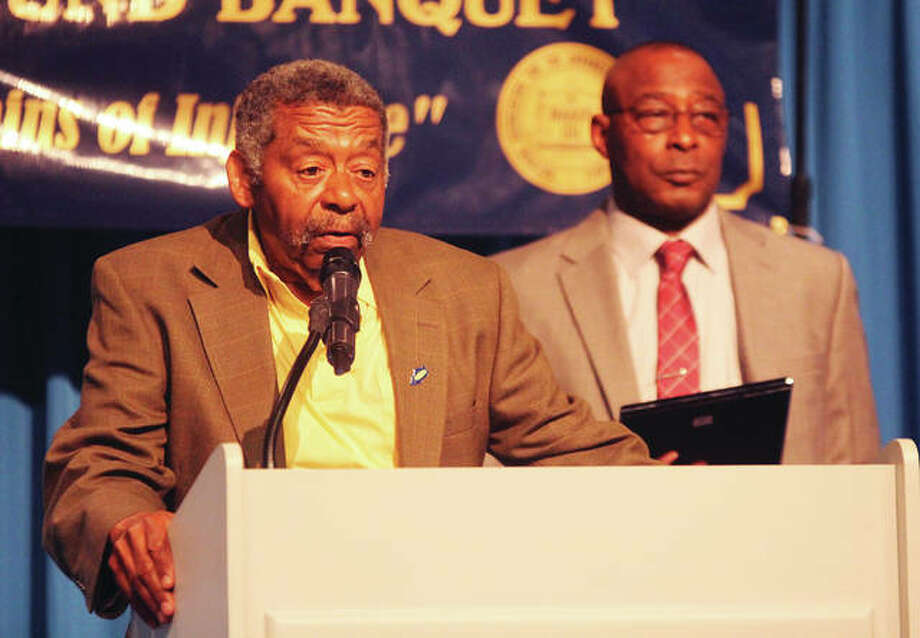 Ed Gray speaks after receiving a Community Service award at the 51st Annual Freedom Fund Banquet of the Alton Branch of the NAACP. Behind him is Alton NAACP President Andy Hightower. About 350 people attended the event, held Saturday evening at The Commons at Lewis and Clark Community College. The theme was Breaking the Chains of Injustice.