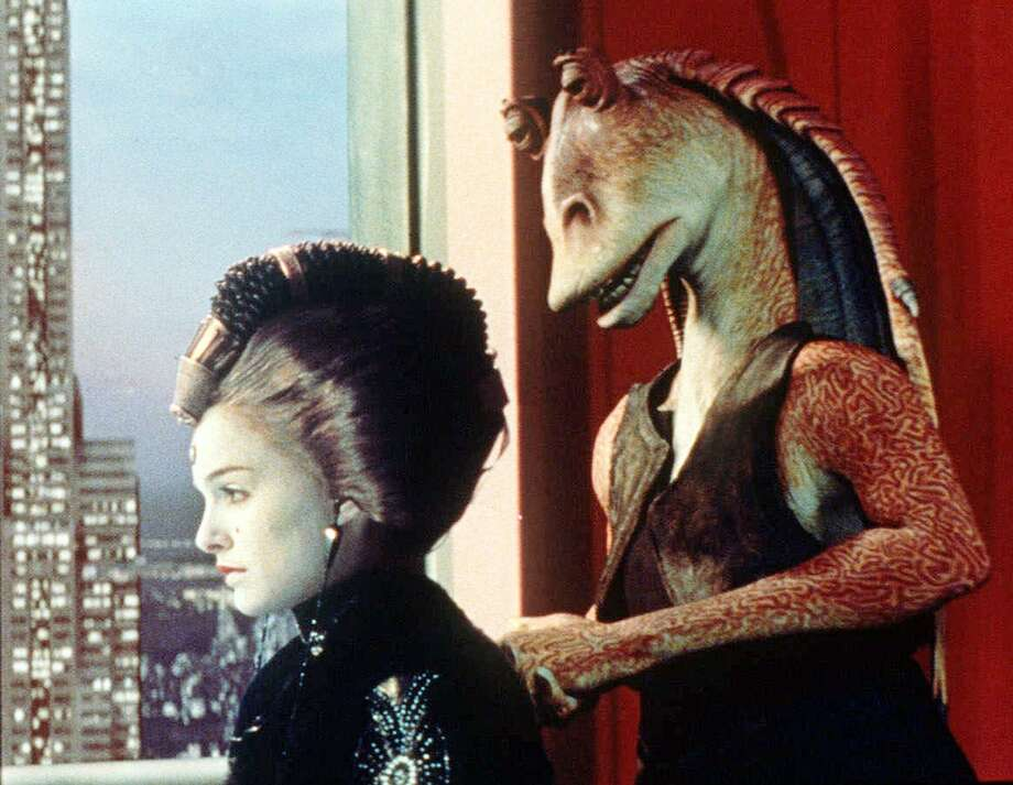 Queen Amidala, played by Natalie Portman, and character Jar Jar Binks are shown in a scene from 'Star Wars: Episode I, The Phantom Menace.' People filled theaters to see ''Star Wars: Episode I _ The Phantom Menace'' over the Memorial Day weekend as the prequel topped the $200 million mark in a record 13 days. (AP Photo/Lucasfilm Ltd. All Rights Reserved) / LUCAS FILM LTD.