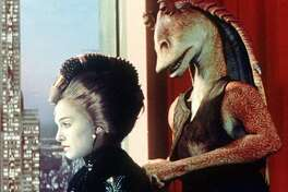 Queen Amidala, played by Natalie Portman, and character Jar Jar Binks are shown in a scene from 'Star Wars: Episode I, The Phantom Menace.' People filled theaters to see ''Star Wars: Episode I _ The Phantom Menace'' over the Memorial Day weekend as the prequel topped the $200 million mark in a record 13 days. (AP Photo/Lucasfilm Ltd. All Rights Reserved)