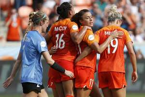 Houston Dash forward Kayla McCoy (16), forward Sofia Huerta (11) and midfielder Kristen Mewis (19) celebrate Huerta's goal against the Chicago Red Stars during the first half of a National Women's Soccer League match at BBVA Compass Stadium on Sunday, May 19, 2019, in Houston.