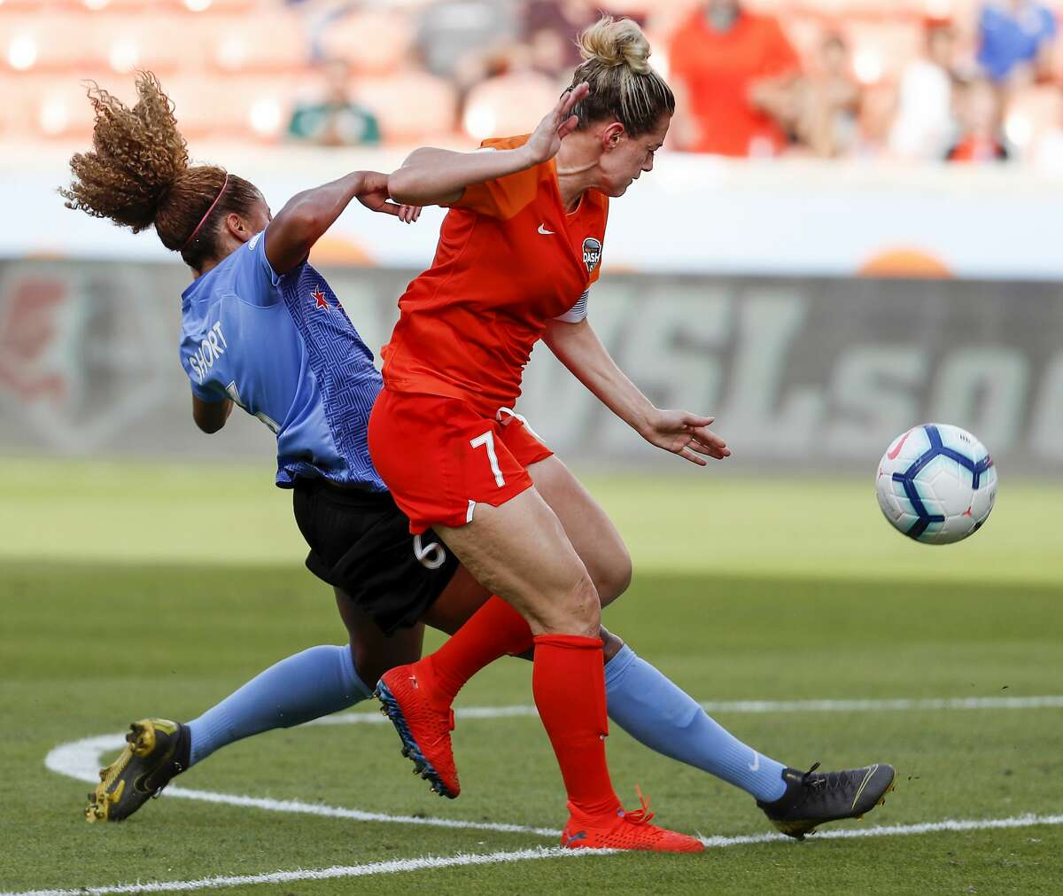 Houston Dash forward Kealia Ohai (7) fights with Chicago Red Stars defender Casey Short (6) for a control of a ball during the second half of a National Women's Soccer League match at BBVA Compass Stadium on Sunday, May 19, 2019, in Houston. The Red Stars beat the Dash 2-1.