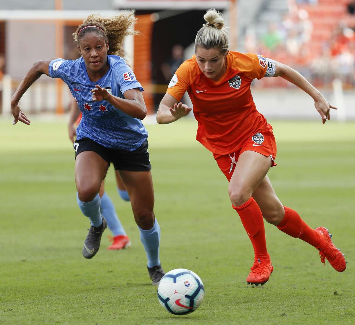 Chicago Red Stars defender Casey Short (6) and Houston Dash forward Kealia Ohai (7) chase down the ball in the Chicago zone during the first half of a National Women's Soccer League match at BBVA Compass Stadium on Sunday, May 19, 2019, in Houston.