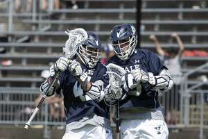 Yale's Jackson Morrill and teammate Matt Brandau celebrate Morrill's first-period goal against Penn on Sunday.