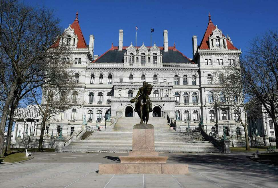 This photo shows an exterior view of the New York state Capitol Monday, April 1, 2019, in Albany, N.Y. A statewide ban on plastic bags and first-in-the-nation tolls for motorists entering the busiest sections of Manhattan are coming to New York under a new state budget that takes several ambitious steps to address long-standing environmental and transportation challenges. (AP Photo/Hans Pennink)