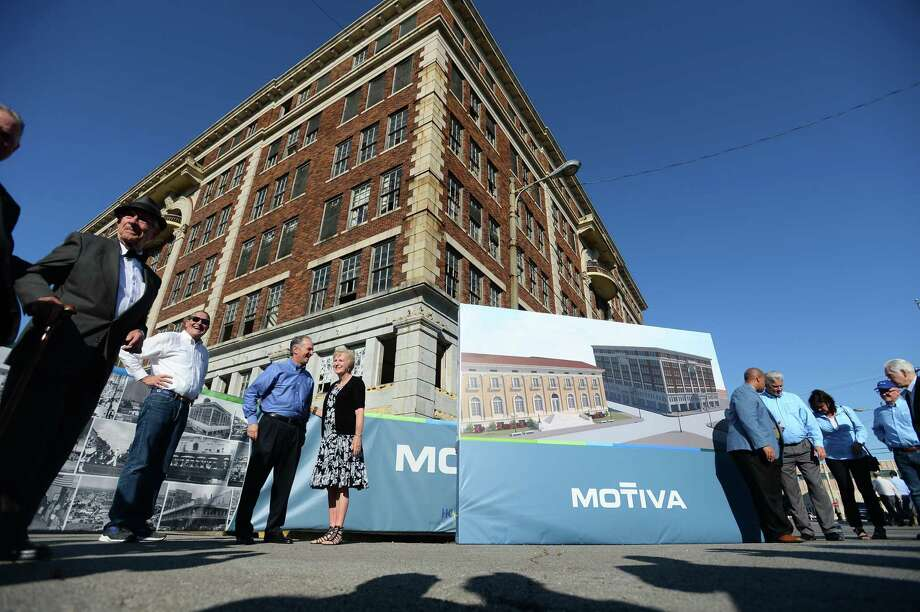 "People from Motiva and Port Arthur unveil building plans in front of the Adams building during Motiva and The Greater Port Arthur Chamber of Commerce's ""Imagine Port Arthur"" in downtown Port Arthur Thursday. Photo taken on Thursday, 05/16/19. Ryan Welch/The Enterprise Photo: Ryan Welch, Beuamont Enterprise / The Enterprise / © 2019 Beaumont Enterprise"