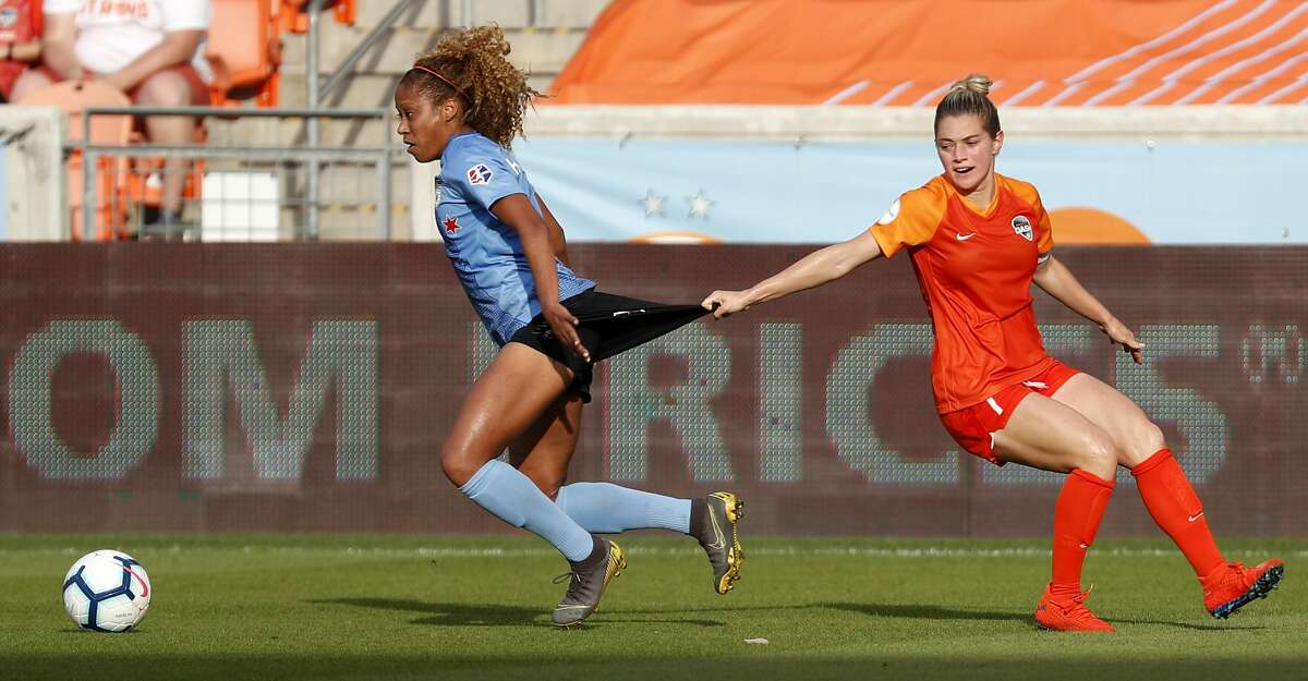 Houston Dash forward Kealia Ohai (7) grabs Chicago Red Stars defender Casey Short's uniform as the fight for control of the ball during the second half of a National Women's Soccer League match at BBVA Compass Stadium on Sunday, May 19, 2019, in Houston. The Red Stars beat the Dash 2-1.