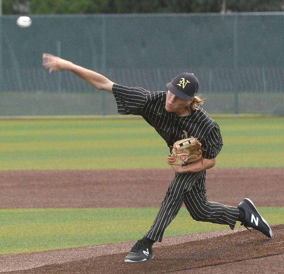 Nederland's Noah Gregory pitches against Port Neches - Groves during game 2 of their quarterfinal match-up Friday night at PNG. Photo taken Friday, May 17, 2019 Kim Brent/The Enterprise Photo: Kim Brent / The Enterprise / BEN