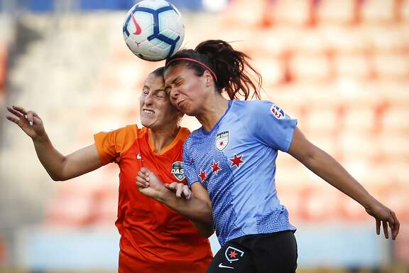 The Dash's Haley Hanson, left, and the Red Stars' Maria Sanchez engage in a painful battle for a header during the second half.