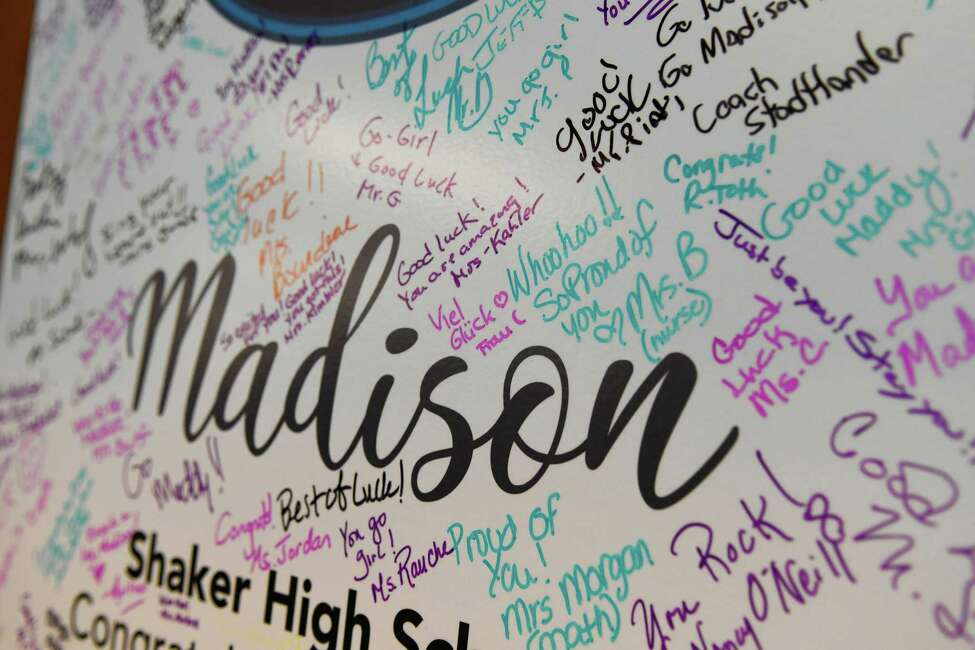 A sign board signed by supporters of Madison VanDenburg, the 17-year-old singer sensation from Latham, N.Y., is seen at Shaker High School during the school's American Idol viewing party for the season finale in which VanDenburg performs on Sunday, May 19, 2019 in Latham. (Jenn March, Special to the Times Union)