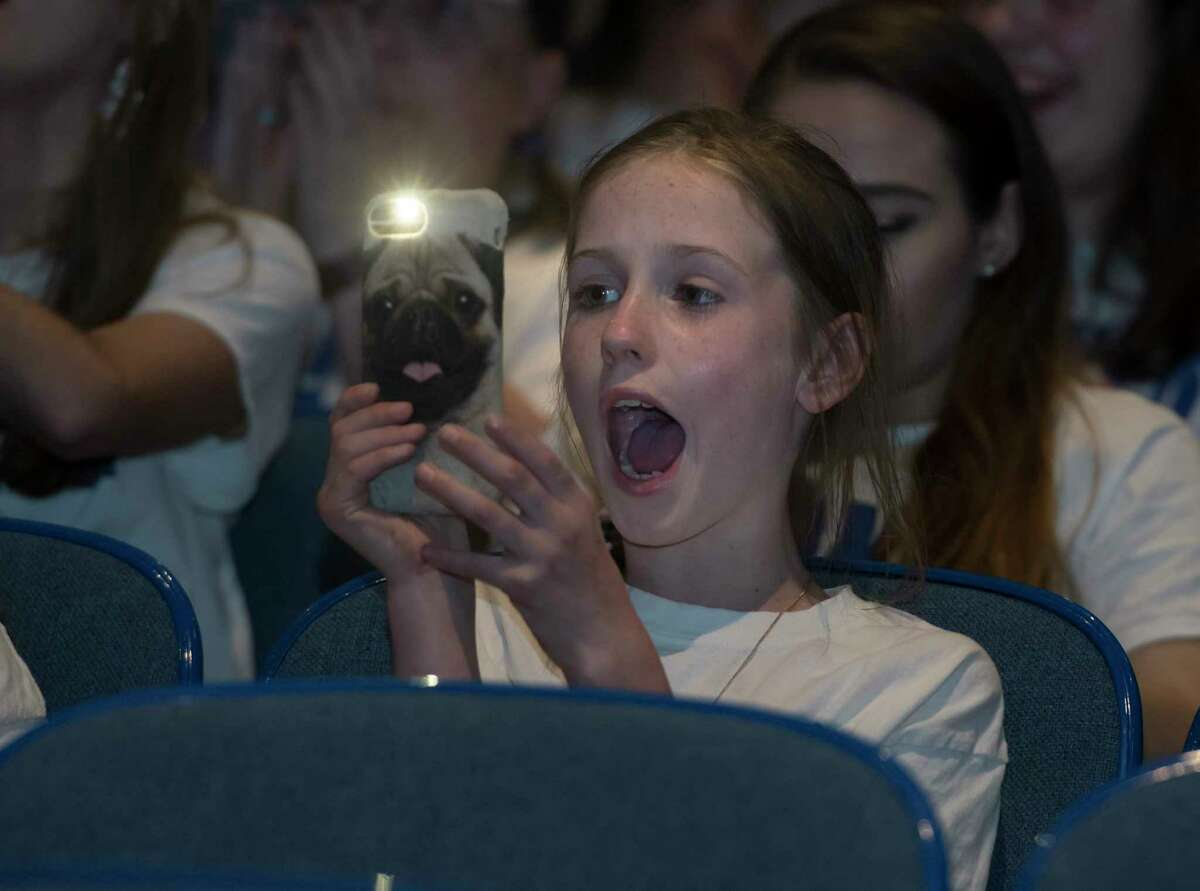Alivia Hamlin of Latham cheers as she films the performance of Madison VanDenburg, the 17-year-old singer sensation from Latham, N.Y., on the final episode of this season's American Idol at Shaker High School on Sunday, May 19, 2019 in Latham. (Jenn March, Special to the Times Union)