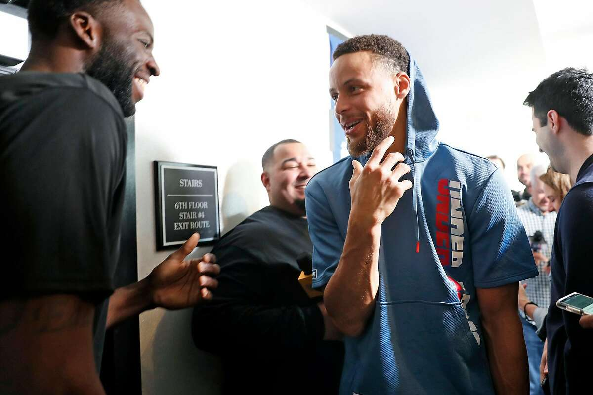 Golden State Warriors' Stephen Curry reacts as Draymond Green makes fun of his Under Armour outfit during media availability at The Nines Hotel in Portland, Oregon on Sunday, May 19, 2019.