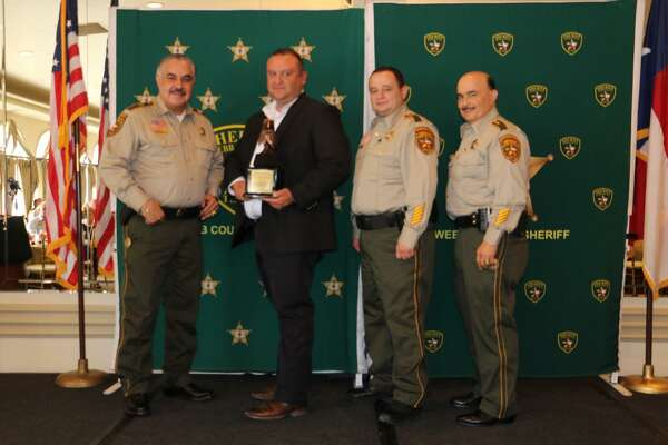 Webb County Sheriff Martin Cuellar, Assistant Chiefs J.J. Rendon and Wayo Ruiz honored Capt. Federico Calderon as the Officer of the Year.