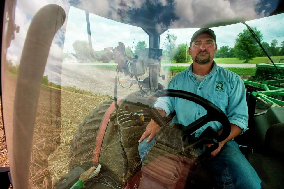 In this May 22, 2019, photo, farmer Tim Bardole plants a field near Perry, Iowa. Donald Trump won the presidency by winning rural America, in part by pledging to use his business savvy and tough negotiating skills to take on China and put an end to trade practices that have hurt farmers for years. While the prolonged fight has been devastating to an already-struggling agriculture industry, there?s little indication Trump is paying a political price. (Zach Boyden-Holmes/The Des Moines Register via AP)