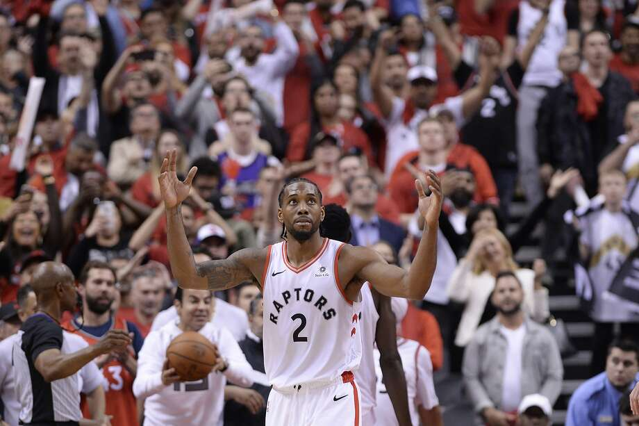 Toronto Raptors forward Kawhi Leonard (2) reacts as following the Raptors win in Game 3 of the NBA basketball playoffs Eastern Conference finals in Toronto on Sunday, May 19, 2019. (Nathan Denette/The Canadian Press via AP) Photo: Nathan Denette, Associated Press