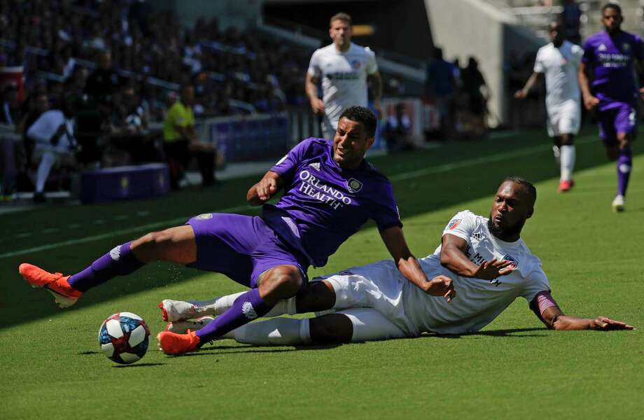 Orlando City's Tesho Akindele, left, and FC Cincinnati's Kendall Waston battle for possession of the ball during the first half of an MLS soccer match, Sunday, May 19, 2019, in Orlando, Fla. (AP Photo/John Raoux) Photo: John Raoux / Copyright 2019 The Associated Press. All rights reserved