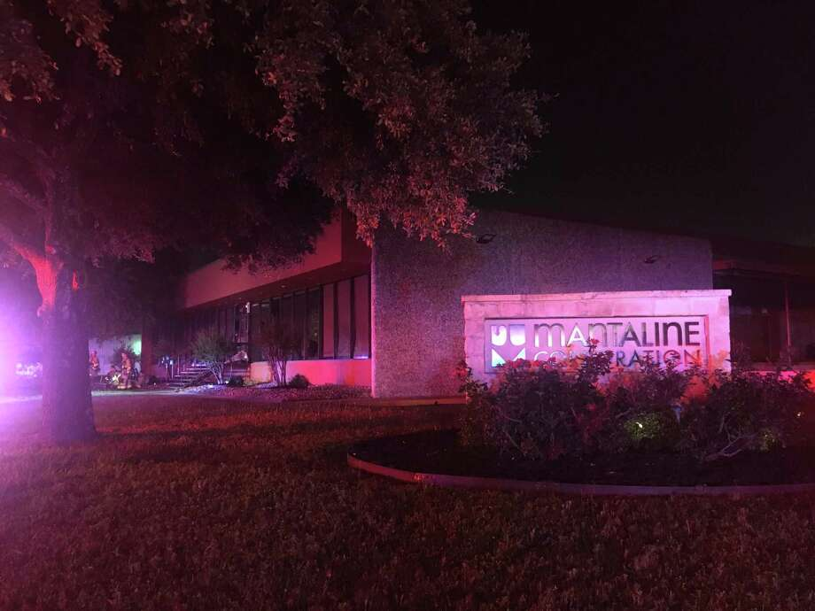 Firefighters responded to a two-alarm fire Sunday night at the Mantaline Corp. on Dividend and Grubb. The company produces rubber materials at the site. Photo: Liz Teitz /Staff