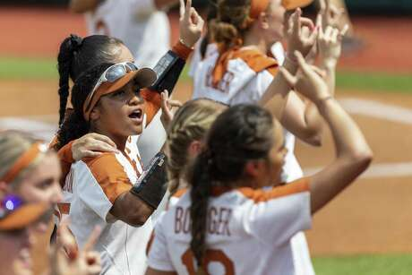 Texas left fielder Kaitlyn Washington (25) stands for the ÒEyes of TexasÓ before an NCAA college softball tournament Austin Regional game, Sunday, May 19, 2019.(Stephen Spillman / for Express-News)