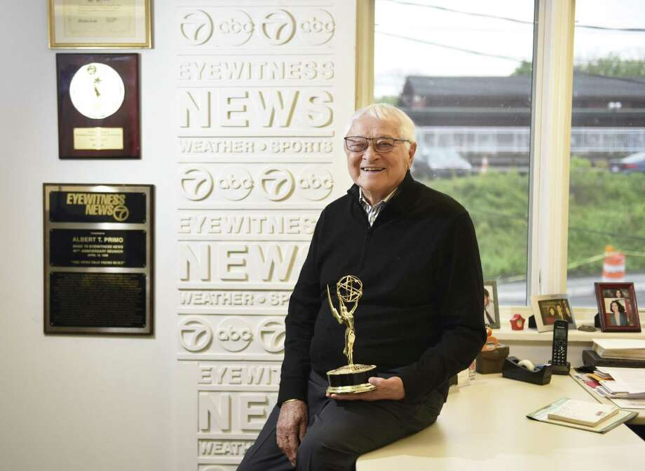 Al Primo poses with his Emmy award at the Al Primo News Services office in Old Greenwich on Monday. Primo is credited with creating the Eyewitness News format that starting giving reporters screen time in addition to just the news anchors. He recently won an Emmy for lifetime achivement in television news. Photo: Tyler Sizemore / Hearst Connecticut Media / Greenwich Time