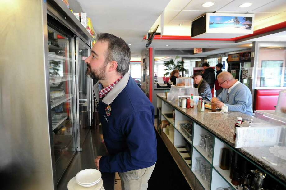 Stamford health inspector Timothy Noia checks the refrigerated cabinets of the Parkway Diner, making sure the food products are properly covered and at a safe temperature during an inspection in 2016. Photo: Michael Cummo / Hearst Connecticut Media / Stamford Advocate