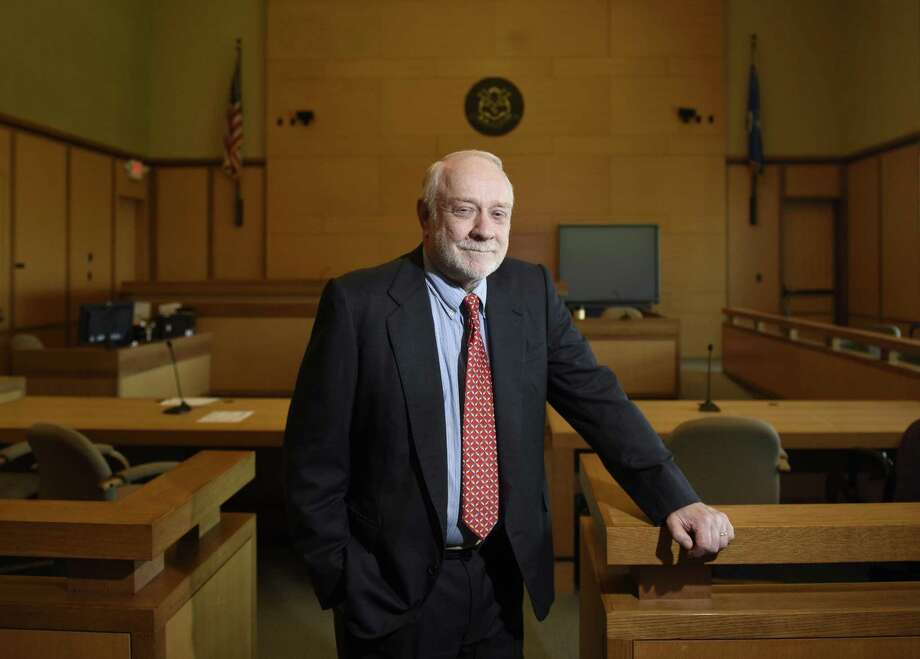 Public defender Howard Ehring poses at the state Superior Court in Stamford on Wednesday. Ehring is the longest serving public defender in Stamford and has worked a number of prominent cases over his 30-plus year career. Photo: Tyler Sizemore / Hearst Connecticut Media / Greenwich Time
