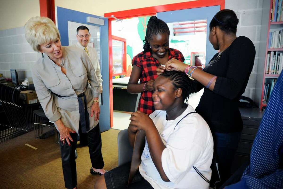 Republican U.S. Senate candidate Linda McMahon stops to chat with Kayla Thompson, 12, Khaila McClintock, 13, and Vemise Louis, 13, as they braid each others hair during McMahon's tour of the Stamford Boys & Girls Club in Stamford, Conn. on Wednesday June 28, 2010.