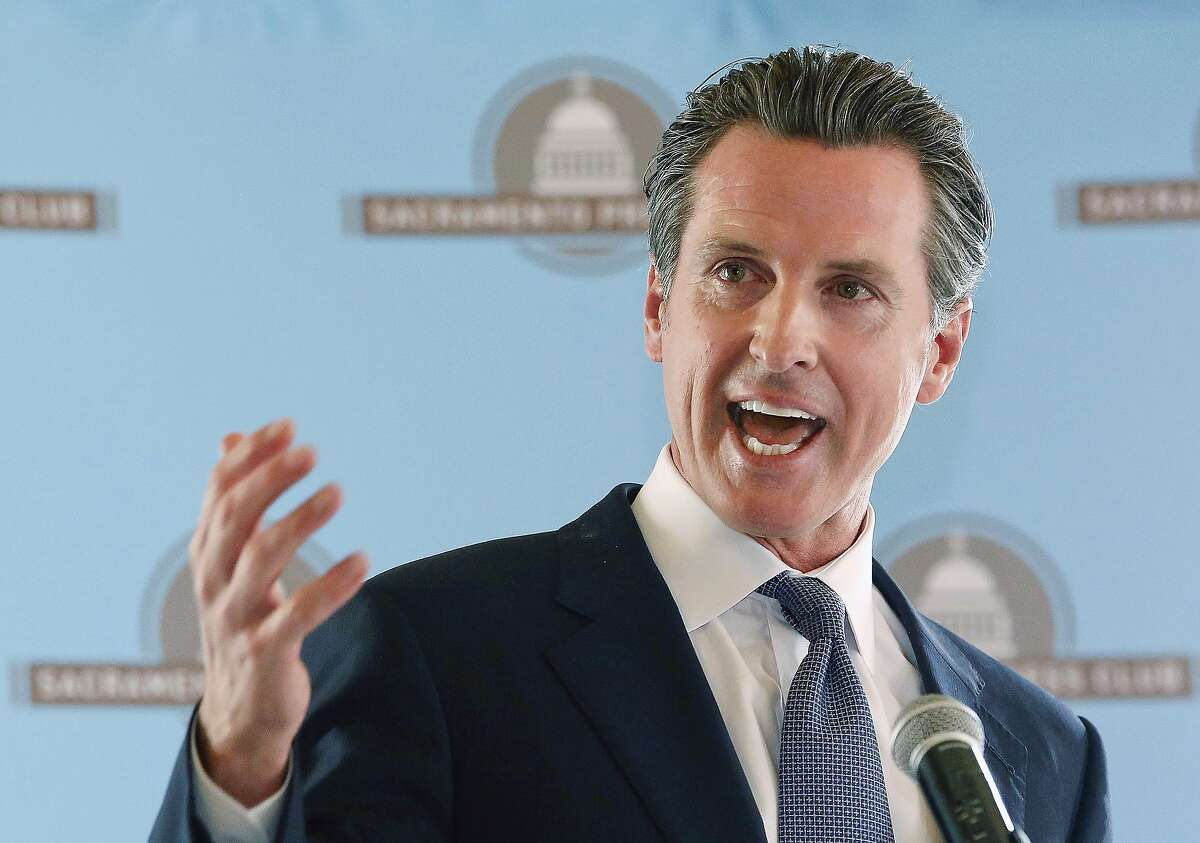 FILE - In this Oct. 19, 2016, file photo, then Lt. Gov. Gavin Newsom affirms he no longer opposes California's high-speed rail plan while speaking at the Sacramento Press Club in Sacramento, Calif.